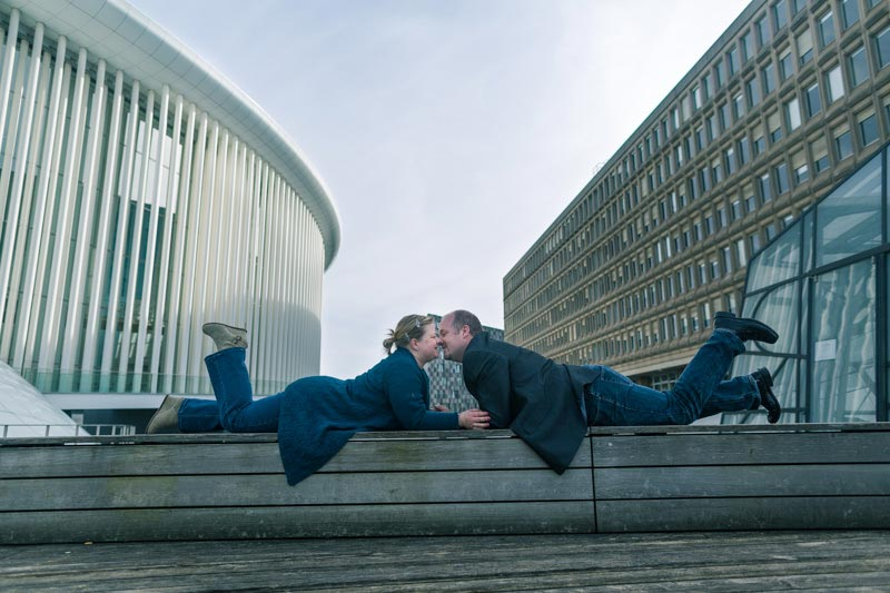 the photographer asked the fiancés to lay down