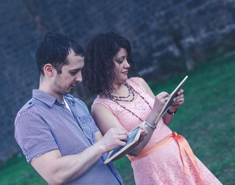 couple writing message for engagement photo