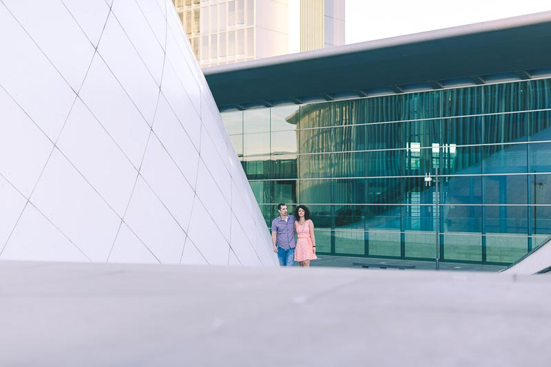 engaged couple in front of modern wedding