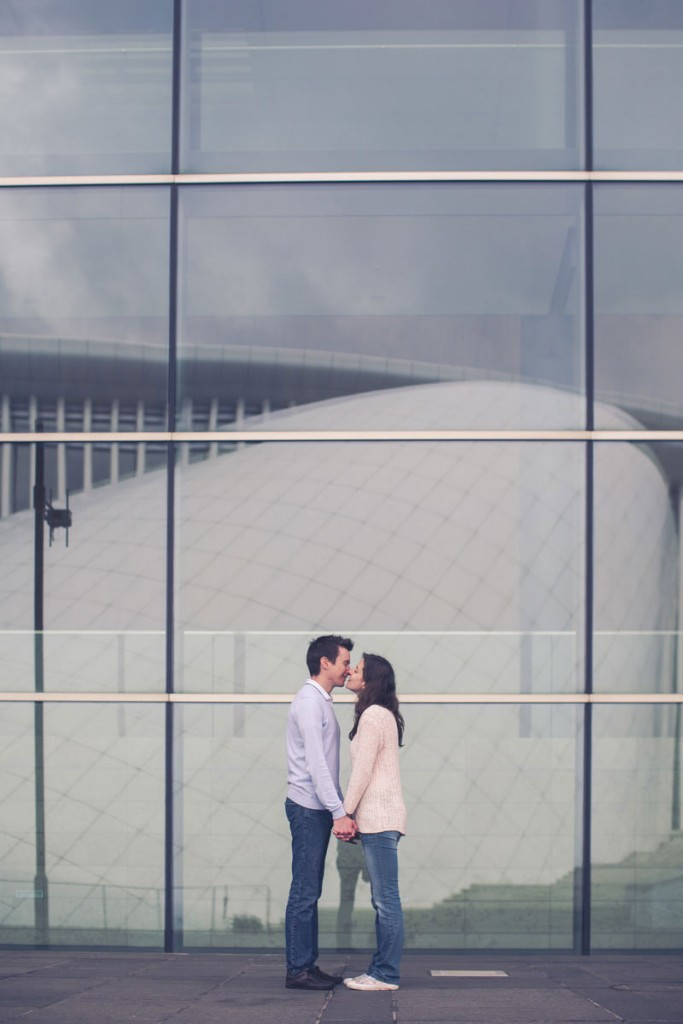 the photographer shot the reflection of the building in front of couple