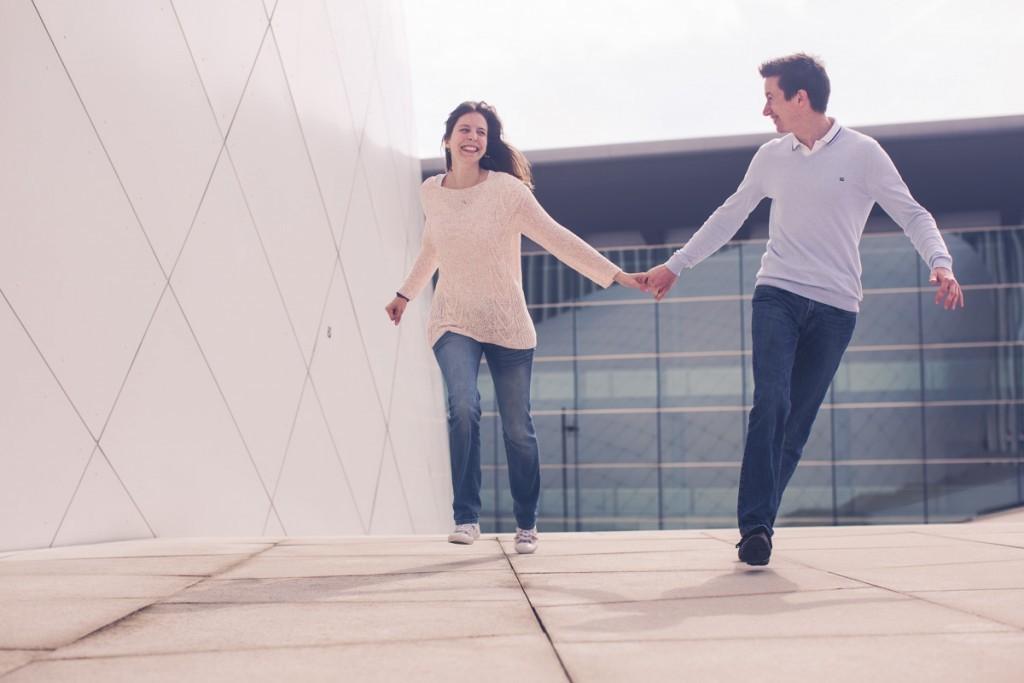 couple running hand in hand