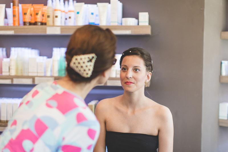 make-up artist checks her work on the bride