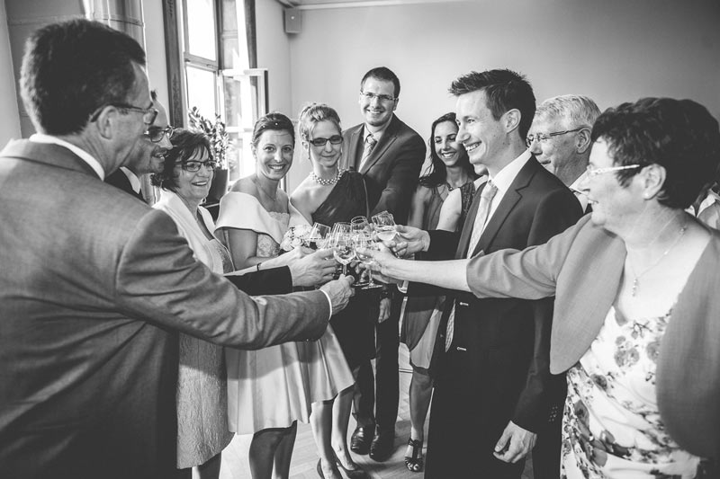 people toasting with champagne after the wedding ceremony