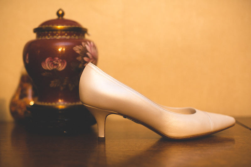 the photographer capture the shoe of the bride