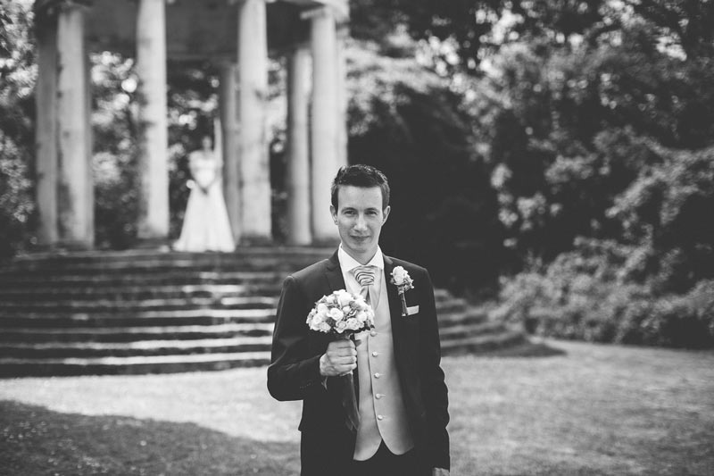 groom holding the bouquet and waiting for his bride