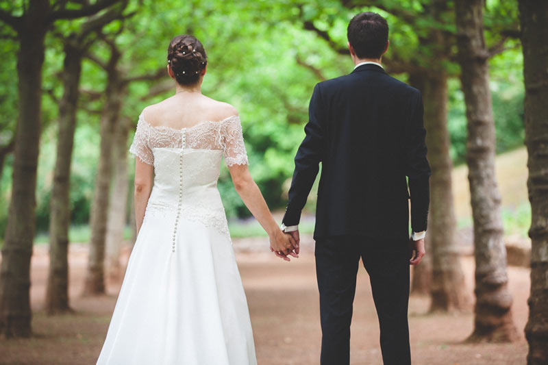 newly-weds walking hand in hand