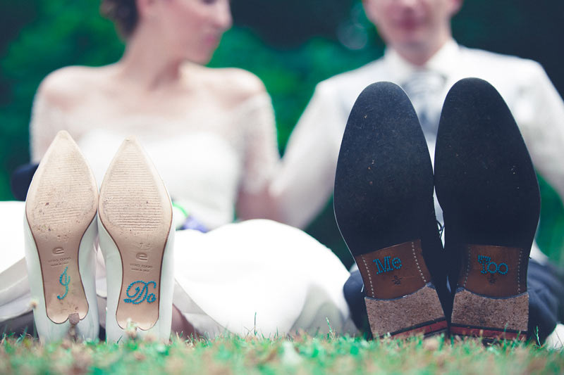 wedding shoes decorated with text 'I do... me too!'