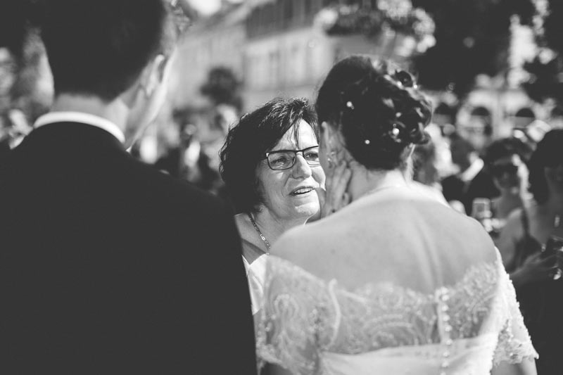 emotional moment when mother caress her daughter's face after wedding ceremony