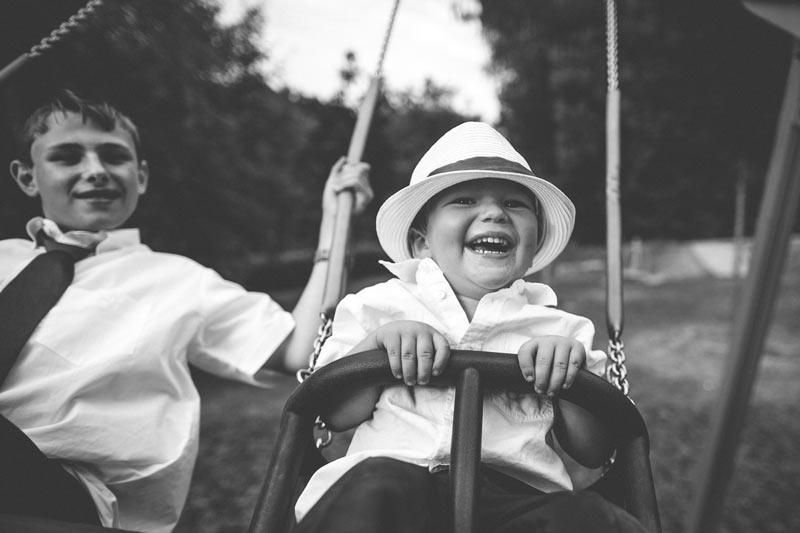 kid laughing on his swing