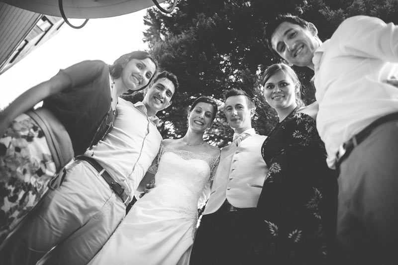 the photographer took this group photo during the wedding party
