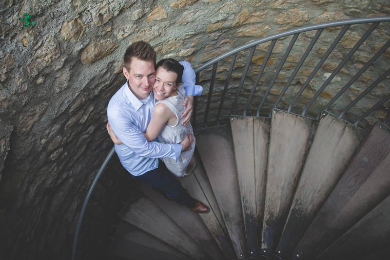 couple photographed in a staircase