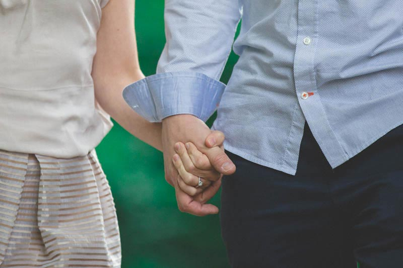 the photographer zoomed on the couple's hands