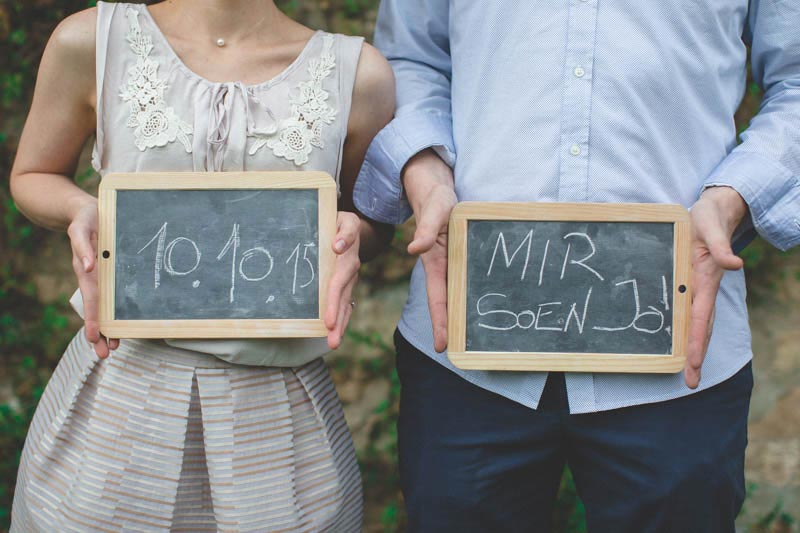 the photographer uses slates and chalk during the engagement session