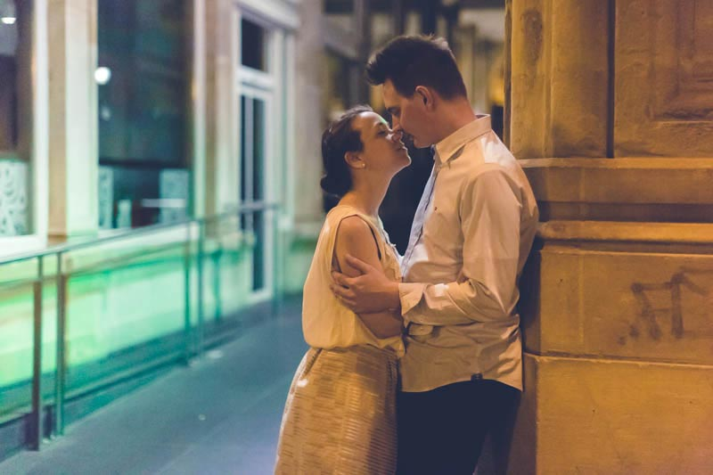 bride and groom kissing each other at night