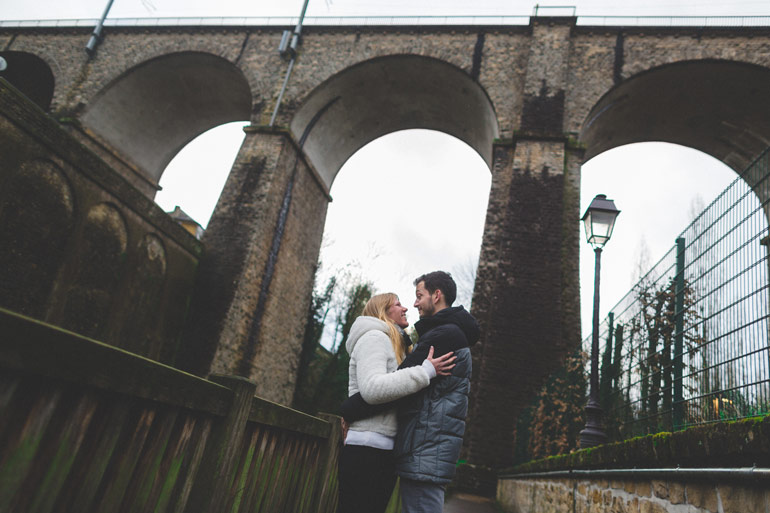 a great shot of bridal couple under a bridge of luxembourg