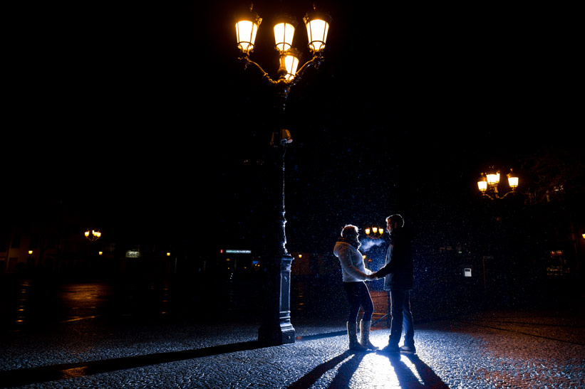 bridal couple lit backward by external flash of the photographer