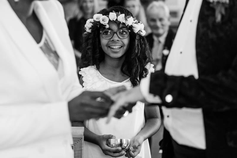 19 girl smiling during wedding ring exchange