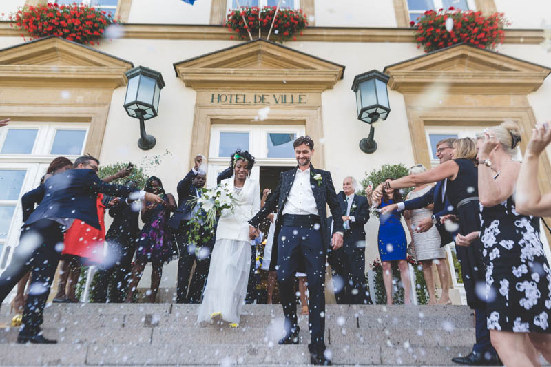 21 newlyweds coming out of luxembourg city hall