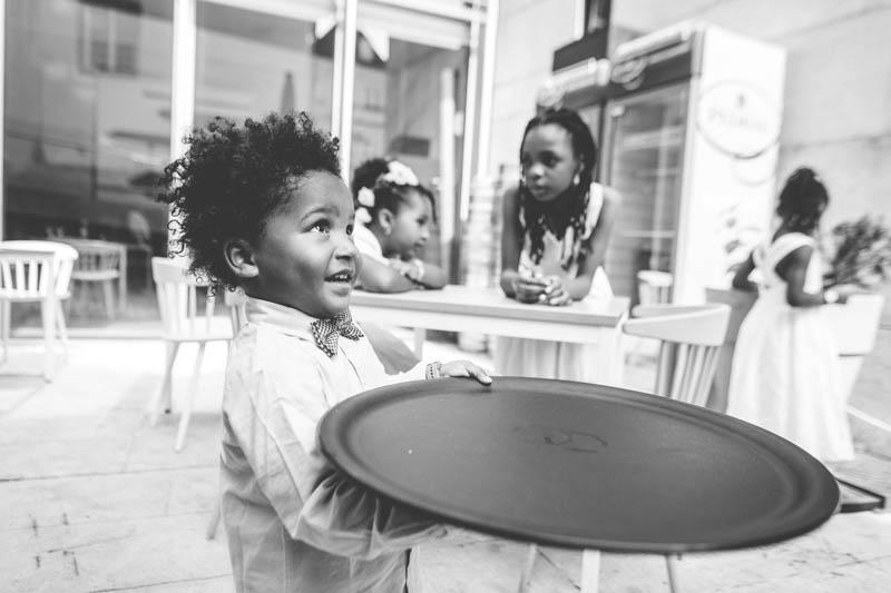38 child trying to imitate waiter