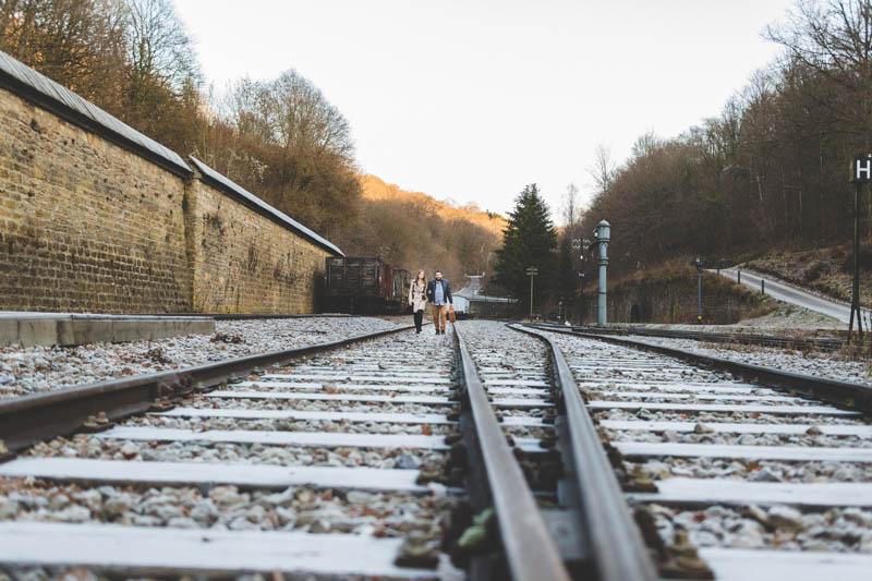 01 couple walking on railroad track