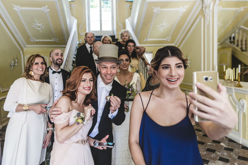 a selfie with the newlyweds