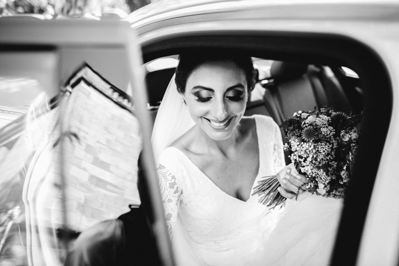 the bride gets in the car