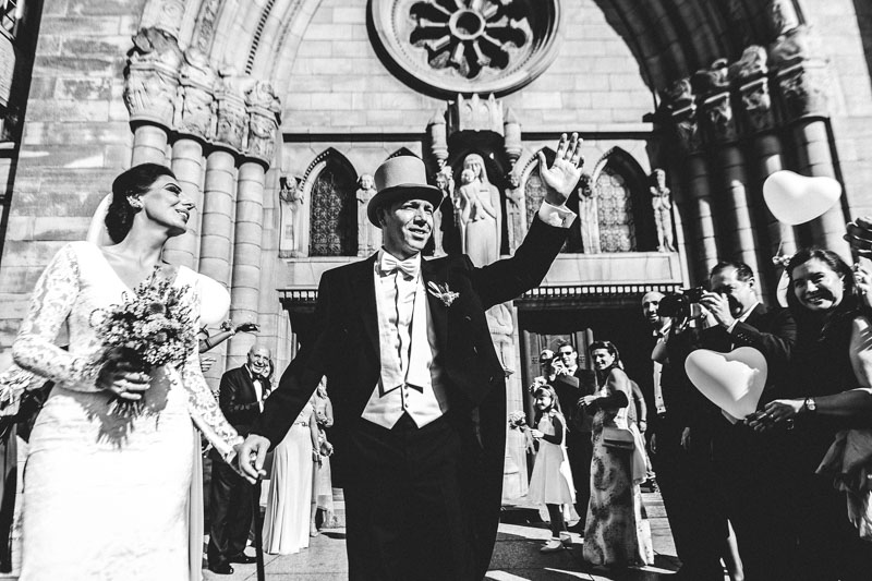 bride and groom salute their guests