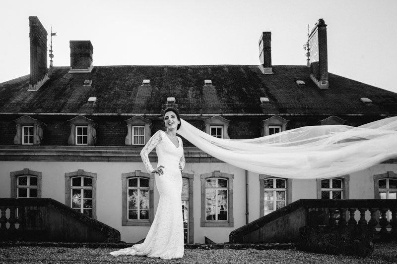 bride's dress is flying
