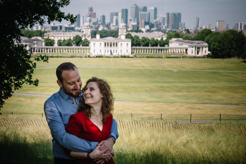 engaged couple posing in greenwich park