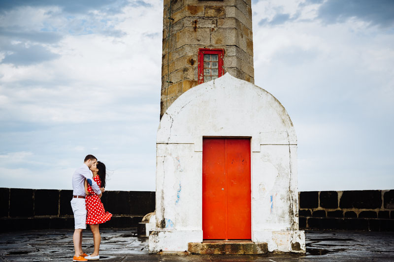 lighthouse with red door
