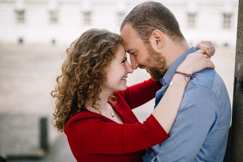 girl in red dress is in love with young man