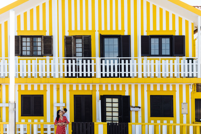 couple in front of yellow house in Aveiro Portugal