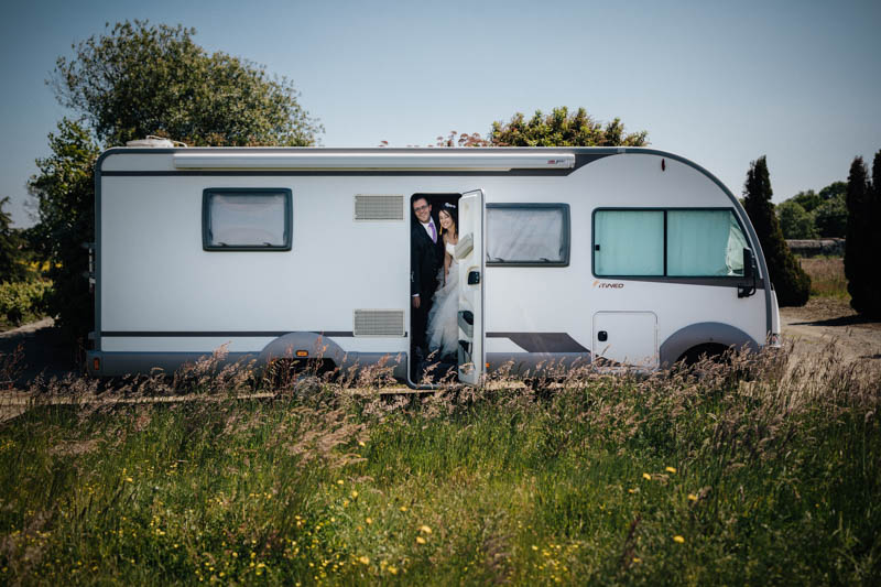 bride and groom in a camping car