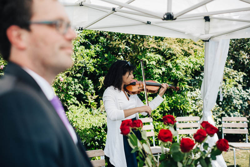 playing violin during wedding ceremony
