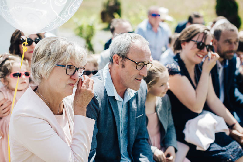 groom parents crying during ceremony