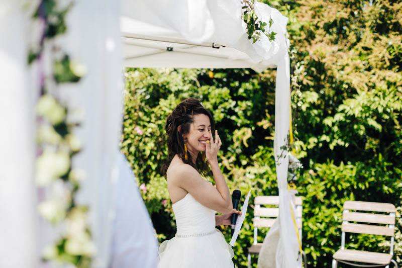 bride crying in a beautiful garden