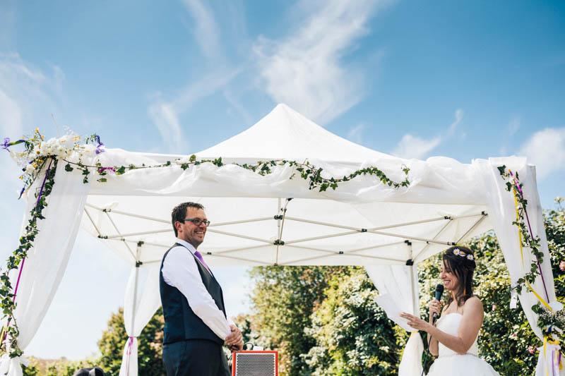 wedding photographer crouching to give drama to photo