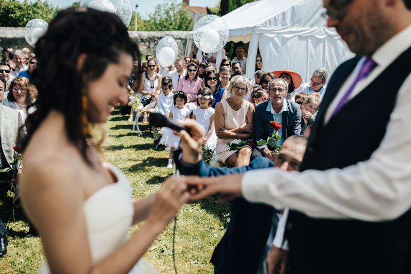exchanging rings during symbolic ceremony