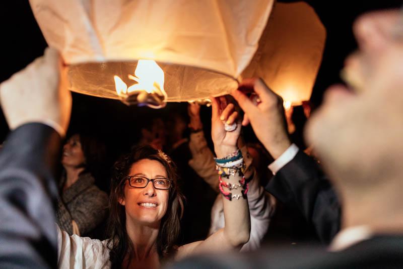 bride and groom lighting up paper lantern