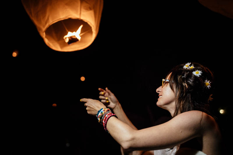 bride let go a paper lantern in the sky